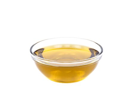 Extra virgin oil in bowl separated on white background Фото со стока - 53749360