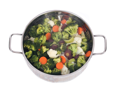 Steam cooked vegetables on stainless steel steamer Standard-Bild