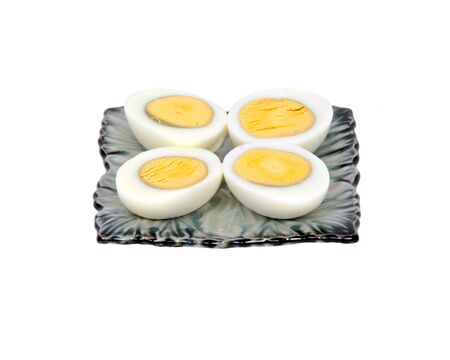 Boiled eggs on plate separated on white background