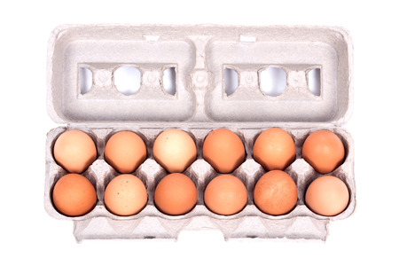 dozen: Dozen organic eggs in a box separated on white background Stock Photo