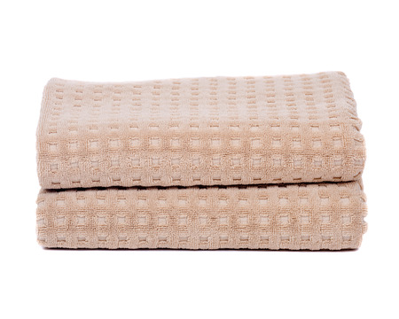 Organic cotton folded bath towel separated on white background