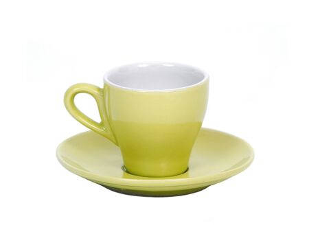 Green coffee cup on saucer separated on white background Фото со стока