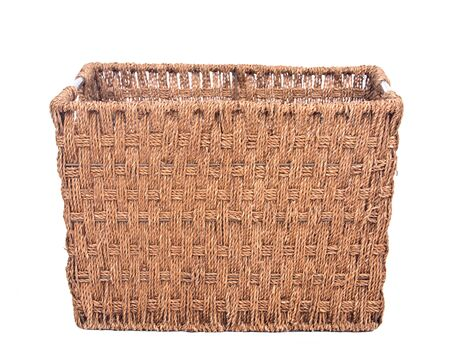 Vintage seagrass storage basket separated on white background Фото со стока