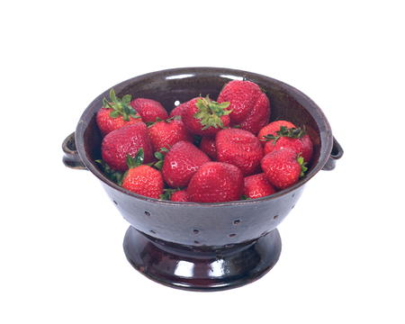 Fresh organic strawberries in berry bowl separated on white background