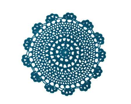Green fabric lace doily separated on white background