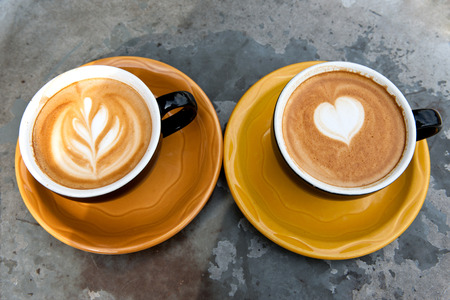 mocha: Art milk mocha coffee with foam on metal table Stock Photo