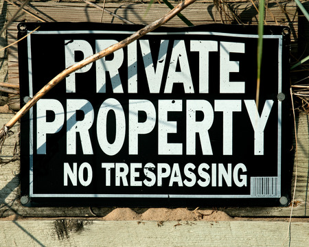 Black and white sign private property no trespassing Stock Photo