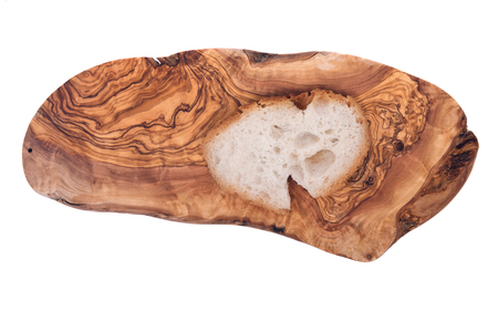 soaked: Soaked organic fresh french bread on olive wood cutting board