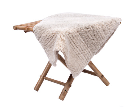 Cotton linen cut pile rug on natural bamboo table