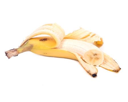 Peeled organic banana isolated on white background