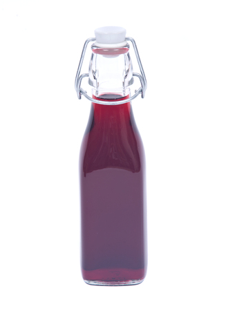 liqueur bottle: Homemade raspberry liqueur in clear glass bottle with swing top isolated on white background