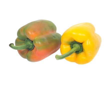 organic peppers: Two ripe organic peppers isolated on white background