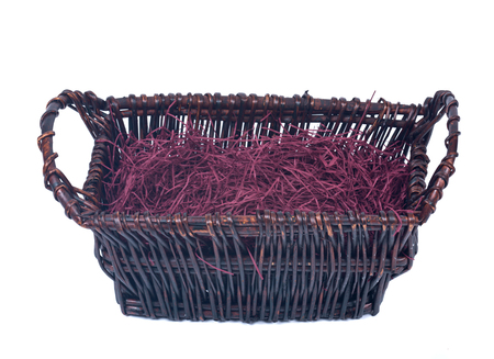 shredded paper: Empty wicker basket for gifts with shredded paper isolated on white background