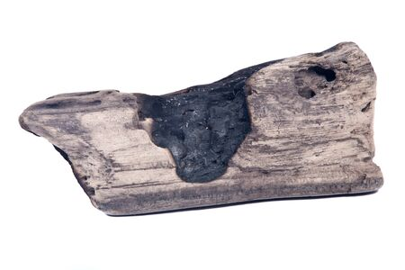 Partly burned charred piece of wood from beach isolated on white background Stock Photo - 66959275