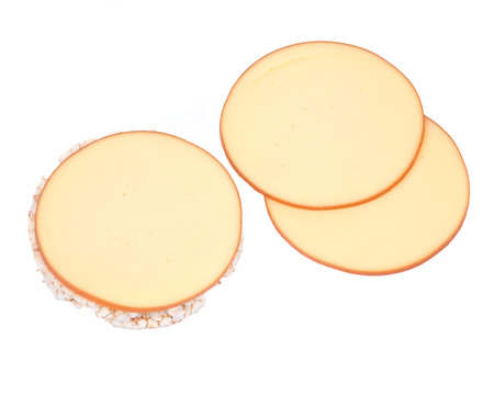 amish: Sliced amish farm organic smoked gouda cheese and organic brown rice cake isolated on white background Stock Photo