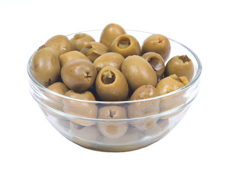 Green colossal olives hand stuffed with jalapeno peppers in bowl isolated on white background