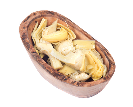 ascorbic acid: Food of love, marinated artichokes in olive wood bowl isolated on white background