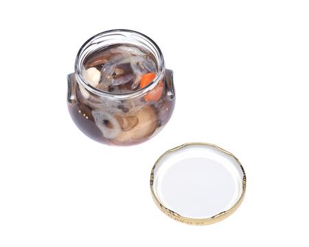 ascorbic acid: Shiitake marinated mushrooms in jar isolated on white background