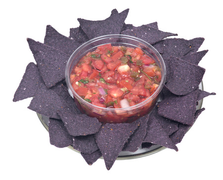 gallo: Pico de gallo, authentic mexican salsa in bpa free plastic container and lightly salted organic blue corn tortilla chips isolated on white background Stock Photo