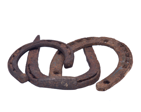 Old rusty vintage good luck horseshoe isolated on white background Stock Photo