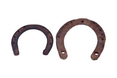 Old rusty vintage good luck horseshoe isolated on white background Stock Photo