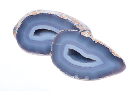 Partially polished blue lace agate geode with crystaline druzy center isolated on white background Stock Photo