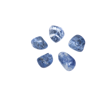 sodalite: Faceted round beads of blue and white sodalite from Africa isolated on white background