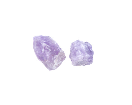 Natural amethyst chunks from Madagascar isolated on white background Stock Photo