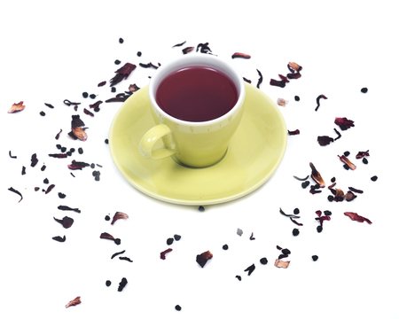 caffeine free: Wild berry tea in green cup with hibiscus leafs isolated on white background