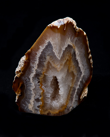 crystaline: Partially polished multicolor agate geode with crystaline druzy center on black background Stock Photo