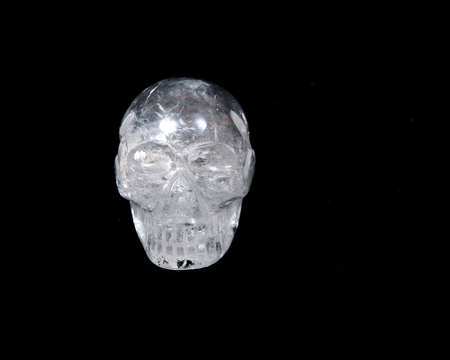Clear quartz skull with rainbow on black background 免版税图像