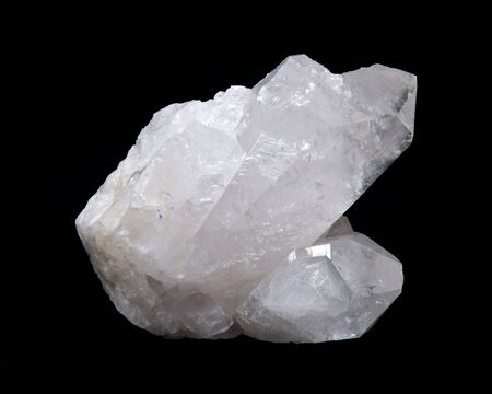 channeling: Clear quartz cluster on black fabric background