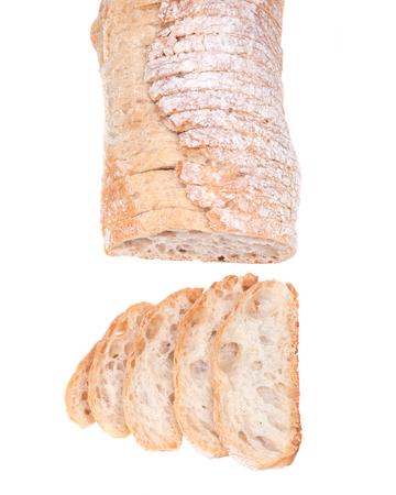 Sliced crusty ciabatta organic italian bread isolated on white background