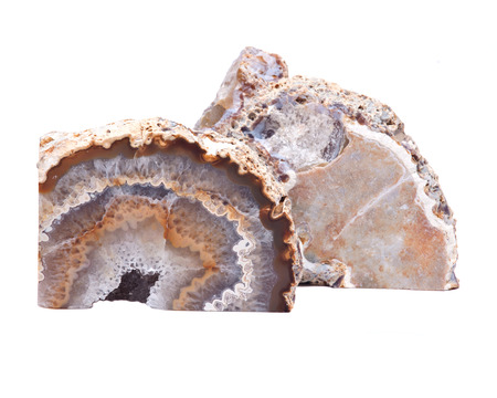 Partially polished multicolor agate geode with crystaline druzy center isolated on white background