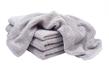 Pile, stock of thick organic cotton bath towels isolated on white background 免版税图像 - 82776286