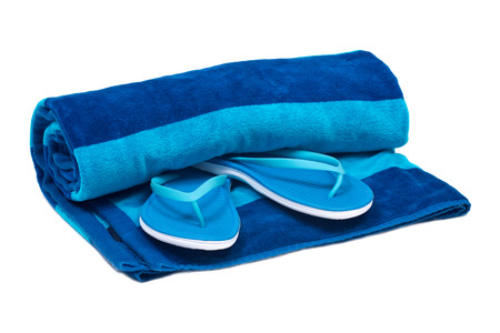 absorbent: Blue cotton beach towel and flip flops isolated on white background