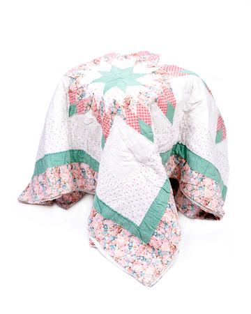 Vintage patchwork cotton blanket isolated on white background Reklamní fotografie