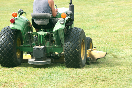 Cutting grass with commercial riding lawn mower