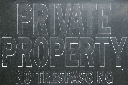 Old vintage private property no trespassing sign, black and white Stock Photo