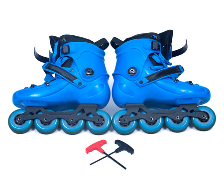Blue roller skates with allen wrench isolated on white background