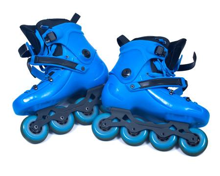 Blue roller skates isolated on white background Stock Photo