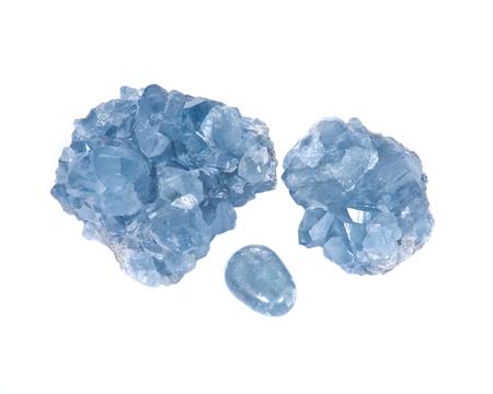 Blue celestite cluster and polished celestite palm stone isolated on white background Stock Photo
