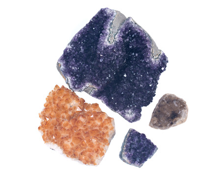Collection of amethyst and citrine druzy clusters, isolated on white background Stock Photo