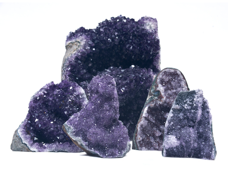 Collection of amethyst druse geodes isolated on white background