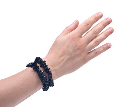 Black Tourmaline Bracelet on womans wrist isolated on white background