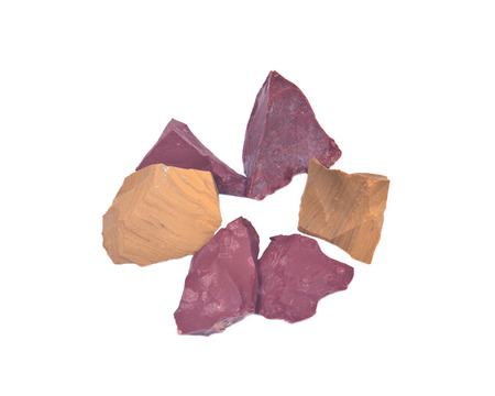 iron oxide: Yellow and red jasper natural chunks from Madagascar isolated on white background