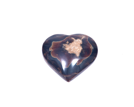 Polished aragonite heart from Peru isolated on white background Stok Fotoğraf