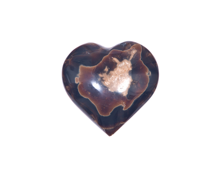 Polished aragonite heart from Peru isolated on white background Stock Photo
