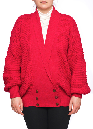 Young woman wearing raspberry long sleeve cardigan sweater isolated on white background