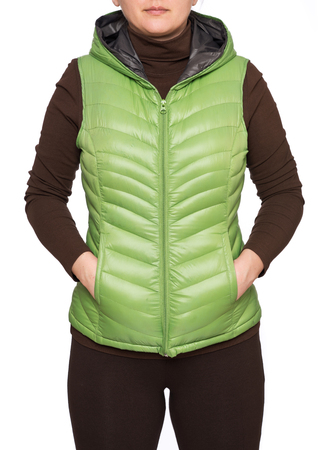 Young woman wearing light green hooded packable down puffer vest isolated on white background